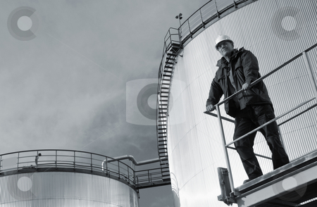 Industrial fuel-tanks and workers stock photo, engineer, overlloking large fuel-storage tanks in refinery by lagereek