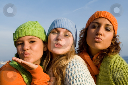 Teen girls blowing kisses stock photo, teen girls blowing kisses by mandygodbehear