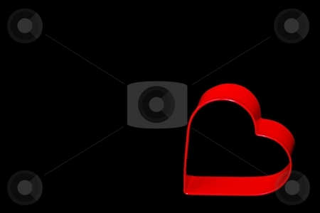 Valentines stock photo, a red heart on a black background by Karma Shuford
