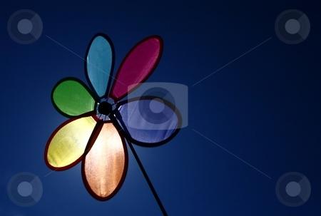 Pinwheel and sky stock photo, A pinwheel against a blue sky by Karma Shuford