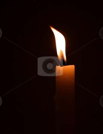 Burning Candle stock photo, a single candle burning in the darkness by Karma Shuford