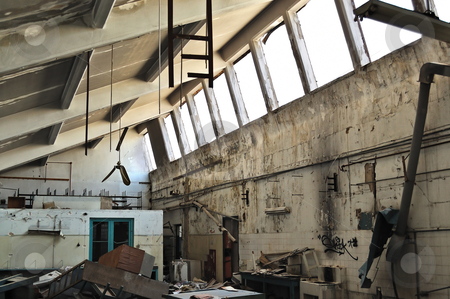 Abandoned factory ruins stock photo, Vandalized equipment and decaying interior of an abandoned factory. by sirylok