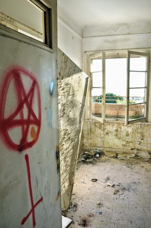 Satanic symbols stock photo, Satanic symbols graffiti on the door of an abandoned house. by sirylok