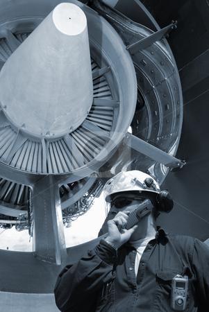 Flight mechanic and jet engine stock photo, mechanic servicing large jumbo-jet engine by lagereek