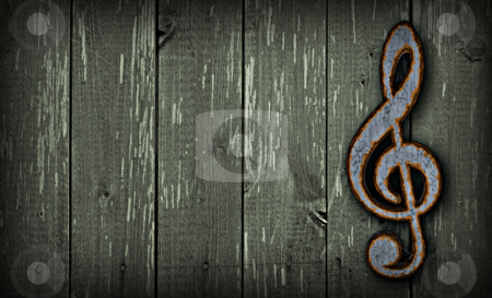 Alternative music stock photo, rusty clef on wooden background - 3d illustration by J?