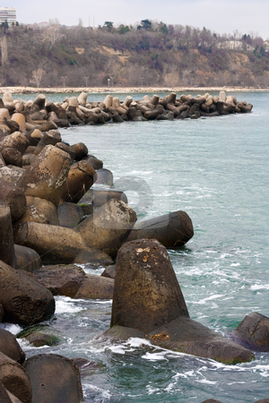 Waterbreak stock photo, Breakwater concrete stones on a cloudy day  in the city of Varna,Bulgaria by borojoint