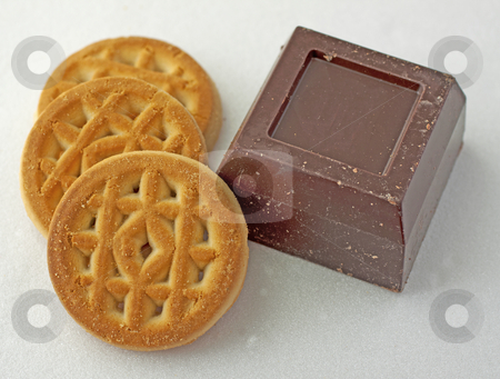 Biscuits and Chocolate stock photo, Close up of biscuits and chocolate on white plate by Fabio Alcini