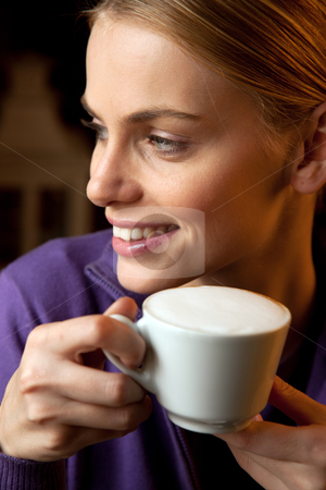 Young woman drinking cappuccino stock photo, young woman drinking cappuccino by ambrophoto