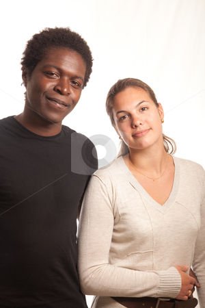 Young couple posing stock photo, a multiracial couple posing together for the camera by Jerax