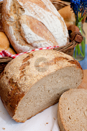 Bread stock photo, Bread and Rolls in Basket on the Table by JAMDesign