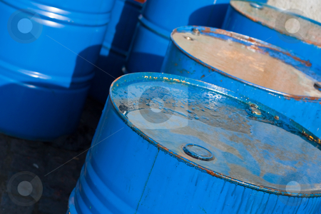 Blue oil barrels (1) stock photo, several blue barrels of oil (1) by stockhouse