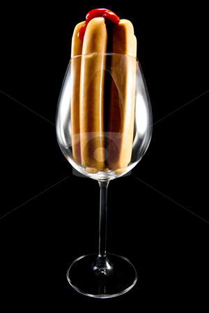 Hot dogs in wine glass stock photo, Picture of some hot dog sausages in a wine glass by Stian Olsen