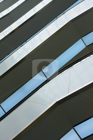 Balconies and escalators in shopping mall stock photo, Rows of balconies and escalators in shopping mall by stockhouse