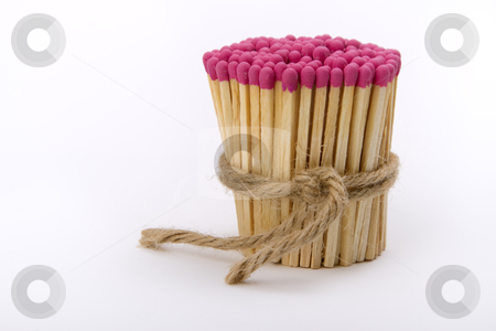 Matches gathered into a tight bundle  stock photo, red matches gathered into a tight bundle and tied with rope by Valery Kraynov