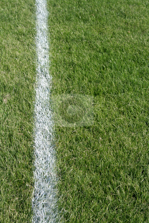 White Line Closeup stock photo, A closeup of a white line on a grass sports field. by Chris Hill