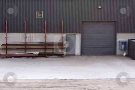 Loading Door Industrial Building stock photo, The loading dock of an industrial warehouse.  by Chris Hill