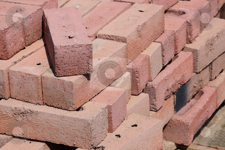Pile of Red Bricks stock photo, A pile of red bricks at a construction site. by Chris Hill