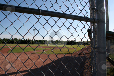 Ball Yard stock photo, A view from behind the fence at a small baseball field. by Chris Hill