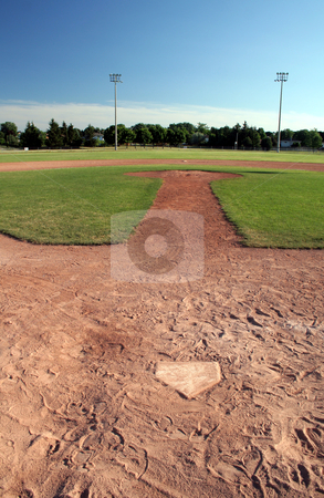 The Ball Diamond stock photo, A view of a baseball diamond at dusk.  by Chris Hill