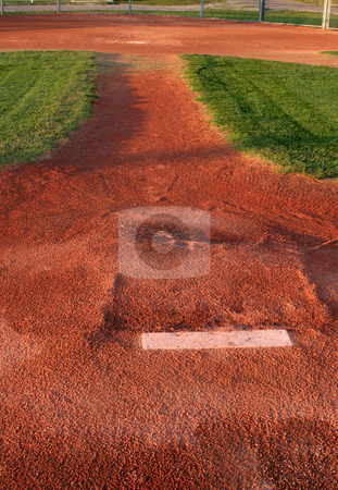 Behind the Mound stock photo, A view from directly behind a pitchers mound.  by Chris Hill