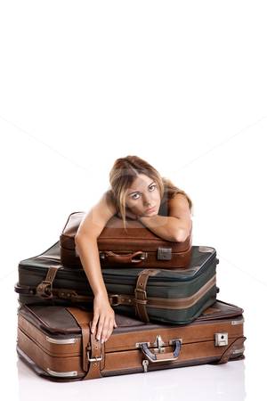 Annoyed Woman stock photo, Beautiful young woman behind the baggage with a sad face, isolated on white background by ikostudio