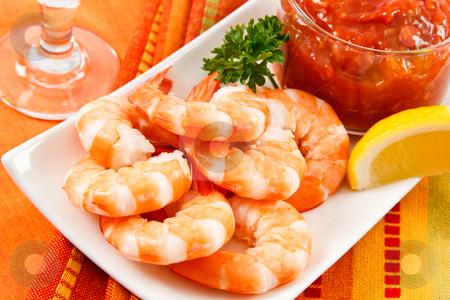 Festive Shrimp Cocktail stock photo, Fresh shrimp are a delicious gourmet appetizer and a dangerous food allergen. by Karen Sarraga