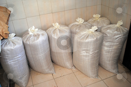 Bags corn stock photo, Bags of Wheat and Corn by freeteo