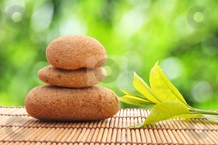 Zen stock photo, zen stack or tower with green summer leaf showing spa or wellness by Gunnar Pippel