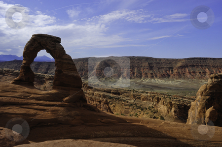 Delicate Arch, Arches National Park stock photo, Delicate arch with sandstone cliffs by Don Fink