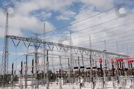 High Voltage Station stock photo, Part of High Voltage Station against blue sky and clouds by Paulo M.F. Pires