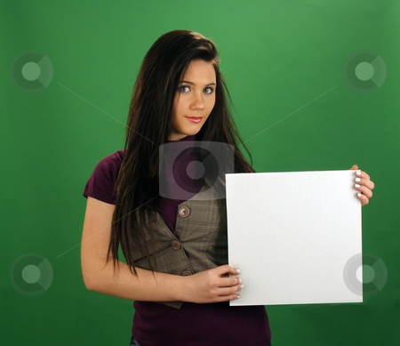 Beautiful Teen Girl Holds a White Card stock photo, A lovely teenage girl with black hair holds a small blank white card. by Carl Stewart