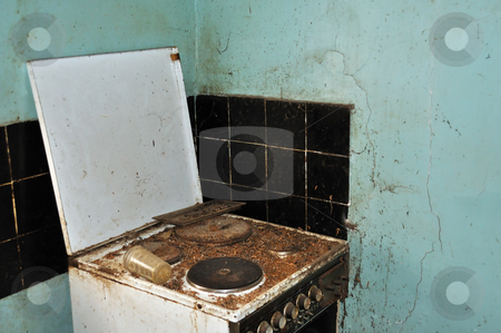 Last meal stock photo, Dirty cook stove and moldy wall. Abandoned house kitchen. by sirylok