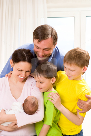 Family in the room stock photo, portrait of a happy family in the room by Alevtina Guzova