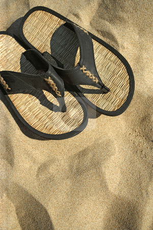 Beach sandals stock photo, An image of sandals resting on the hot sand of a tropical beach. by © Ron Sumners