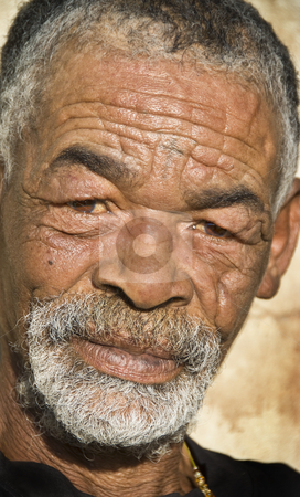 Old African black man with characterful face stock photo, Old African black man with characterful face by tish1