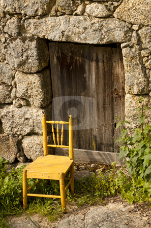 Door of an ancient house stock photo, Door of an ancient house with a chair in the entrance by Neonn