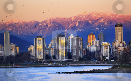 Vancouver Skyline Harbor English Bay Birds Snow Mountains Sunset stock photo, Vancouver Skyline Harbor High Rises Sailboat Birds English Bay From Jericho Beach Snow Mountains Sunset British Columbia Pacific Northwest by William Perry