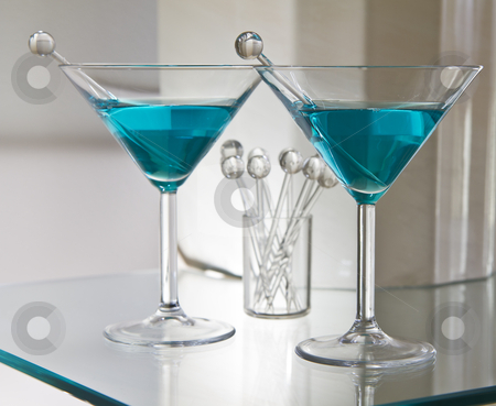 Mixed Drinks stock photo, Dry mixed drinks on glass table with stir sticks by tab62