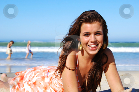 Young woman enjoying summer on the beach stock photo, Young woman enjoying summer on the beach by tish1