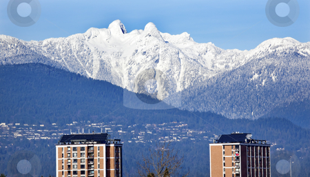 Vancouver Skyline Snowy Two Lions Mountains British Columbia stock photo, Vancouver Skyline Snowy Two Lions Snow Mountains Sunset British Columbia Pacific Northwest by William Perry