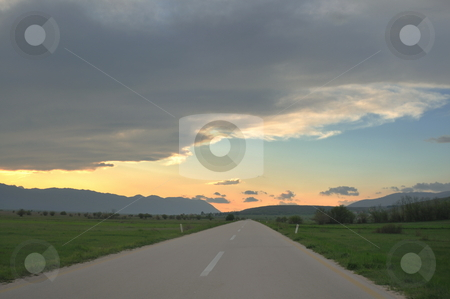 Countryroad adventure with beautiful sunset stock photo, landscape in nature and countryroad adventure with beautiful sunset and dramatic clouds and sky by Benis Arapovic