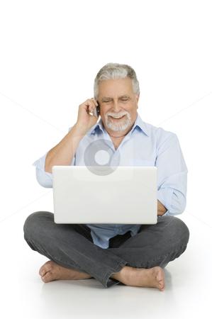 Elderly man using laptop stock photo, elderly man using laptop by ambrophoto