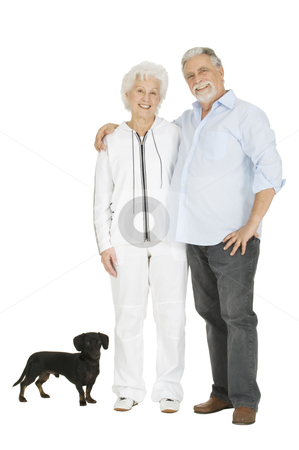 Elderly couple with a dachshund stock photo, elderly couple with a dachshund by ambrophoto