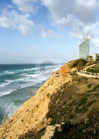 Sea coast and the view on Natania stock photo, Sea coast and panorama of new modern hotel in Natania, Israel by Tatjana Keisa
