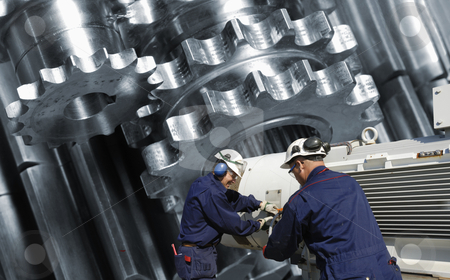 Engineering and technology stock photo, two engineers working, with  giant gears and pinions in background by lagereek