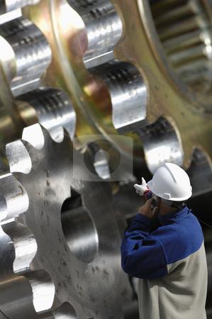 Engineer and steel works stock photo, engineer examining large gear machinery, metal industry works by lagereek