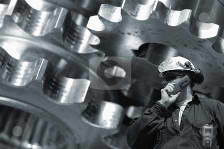 Engineer and steel machinery stock photo, engineer, machinist with large gears, pinion machinery in background, blue toning concept by lagereek