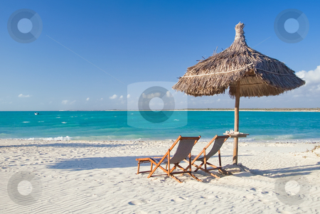 Relax on the beach stock photo, Relax on the beach, deck chair, parasol and lagoon by Pierre-Yves Babelon