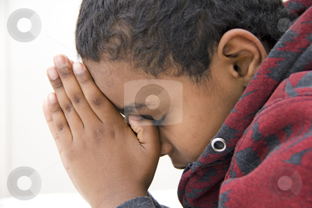 A Young kid praying stock photo, A young kid during his daily prayer by derejeb