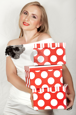 Woman in white dress and red boxes. stock photo, happy beautiful woman with red boxes wearing white party silk dress with lace. by lubavnel